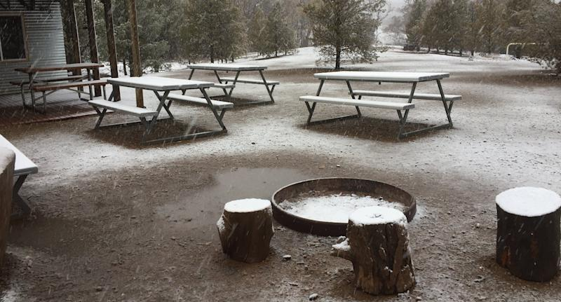 Snow covering the ground and picnic tables at Skytrek Willow Springs Station, South Australia.