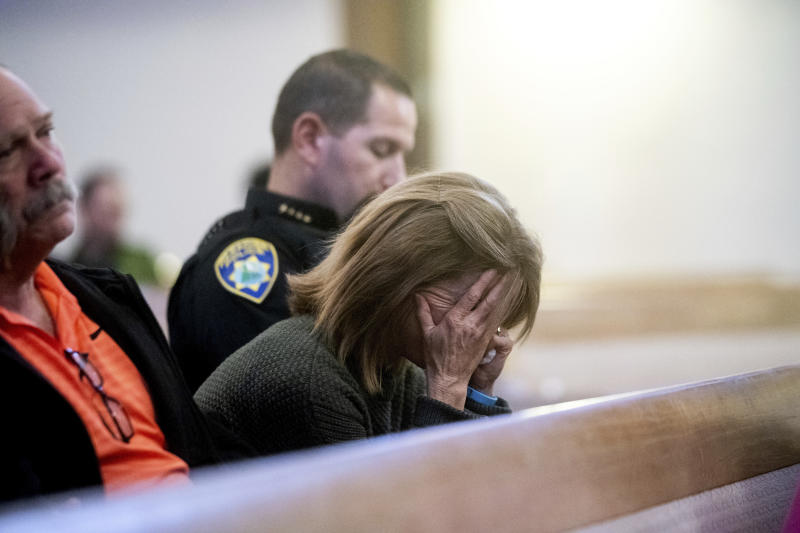 Lauren Gill, the town manager for Paradise, California, cries during a vigil for Camp Fire victims on Sunday at the First Christian Church of Chico. ((AP Photo/Noah Berger, Pool))