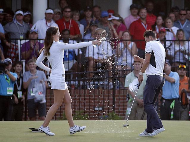 LPGA player Sandra Gal, left, splashes water on Martin Kaymer, of Germany, after he won the U.S. Open golf tournament in Pinehurst, N.C., Sunday, June 15, 2014. (AP Photo/Matt York)