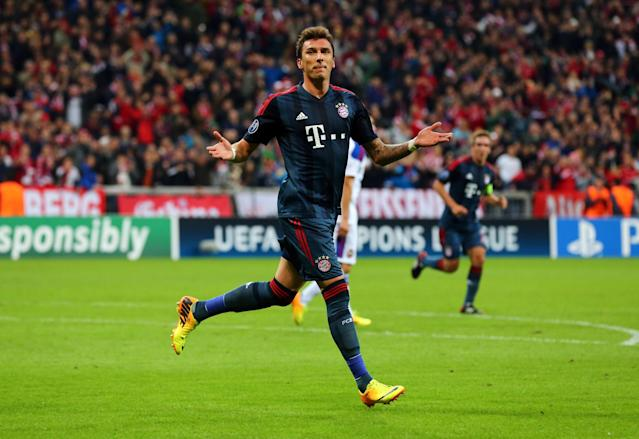 MUNICH, GERMANY - SEPTEMBER 17: Mario Mandzukic of Bayern Muenchen celebrates as he scores their second goal during the UEFA Champions League Group D match between Bayern Muenchen and CSKA Moscow at Allianz Arena on September 17, 2013 in Munich, Germany. (Photo by Martin Rose/Bongarts/Getty Images)