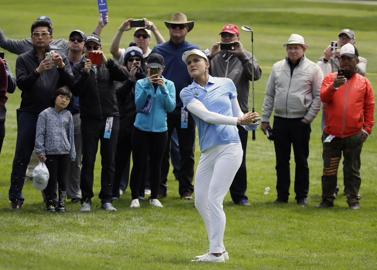 Lexi Thompson follows her shot up to the first green of the Lake Merced Golf Club during the first round of the LPGA Mediheal Championship golf tournament Thursday, April 26, 2018, in Daly City, Calif. (AP Photo/Eric Risberg)