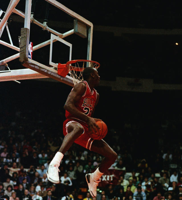 Michael Jordan wears the cement Air Jordan III's during the 1988 Slam Dunk Contest. (Getty Images).