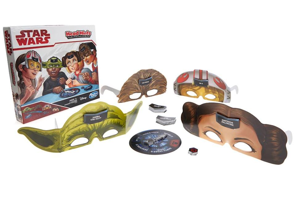 """<p>""""Heads up! In this hilarious game of clues, guesses, and silly stunts, players put on their <em>Star Wars-</em>inspired character glasses, insert a card, and help each other guess which mystery card they have! Can you guess which <em>Star Wars-</em>inspired card you have? The first player to correctly guess six mystery cards wins. The <em>Head Hints: Star Wars</em> Edition game includes 12 mystery cards and four character masks."""" $9.99 (Photo: Hasbro) </p>"""