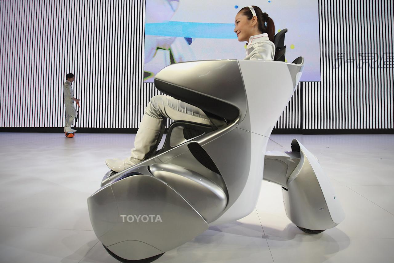 BEIJING, CHINA - APRIL 29:  A model drives a Toyota  i-REAL during the 2012 Beijing International Automotive Exhibition at China International Exhibition Center on April 29, 2012 in Beijing, China. More than 2,000 automotive enterprises from 14 countries and regions participated in the 2012 Beijing International Automotive Exhibition from April 23 to May 2.  (Photo by Feng Li/Getty Images)
