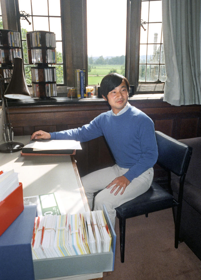 This Sept. 9, 1985, photo shows Crown Prince Naruhito in his dormitory room at the Oxford in England. On May 1, 2019, when Crown Prince Naruhito becomes, by official Japanese count, the nation's 126th person to sit on the Chrysanthemum Throne since 660 B.C., he will be ceremonially armed with the glittering, ancient imperial regalia of sword, mirror and jewel. (Kyodo News via AP)