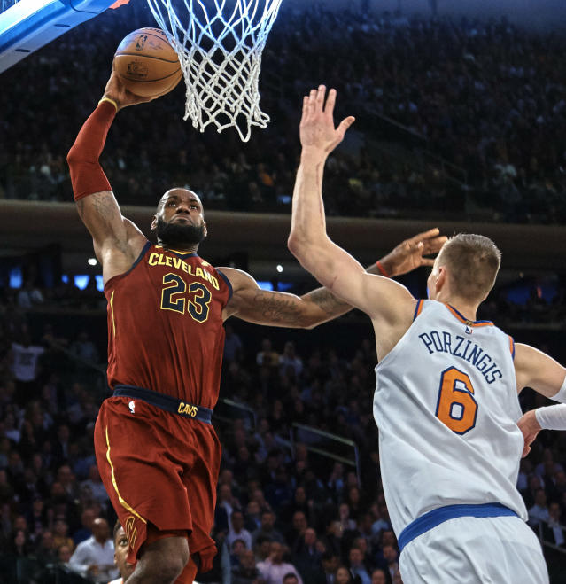 "<a class=""link rapid-noclick-resp"" href=""/nba/players/3704/"" data-ylk=""slk:LeBron James"">LeBron James</a> rises to a place <a class=""link rapid-noclick-resp"" href=""/nba/players/5464/"" data-ylk=""slk:Kristaps Porzingis"">Kristaps Porzingis</a> can't quite reach yet. (AP)"