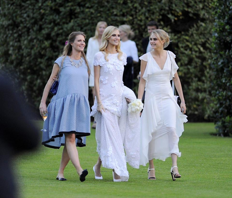 Chloe Delevingne, Poppy Delevingne and Cara Delevingne are seen at Poppy Delevingnes and James Cook's wedding reception held in Kensington Palace Gardens on May 16, 2014 in London, England.