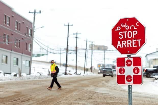 A file photo of a stop sign in Iqaluit. New measures are in place as two new cases of COVID-19 were reported in Kinngait Monday evening. (Natalie Maerzluft/Reuters - image credit)