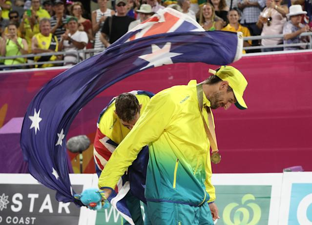 Beach Volleyball - Gold Coast 2018 Commonwealth Games - Men's Medal Ceremony - Coolangatta Beachfront - Gold Coast, Australia - April 12, 2018. Gold medalists Christopher McHugh and Damien Schumann of Australia on the podium. REUTERS/Athit Perawongmetha