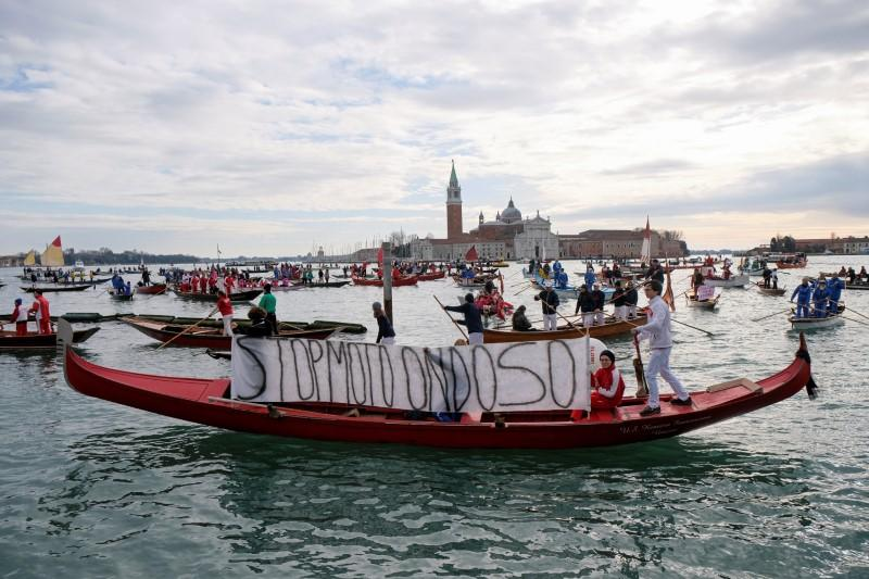 Scores of boats take to the Saint Mark's Basin, as Venetians protest against the damage caused by big ships, in Venice