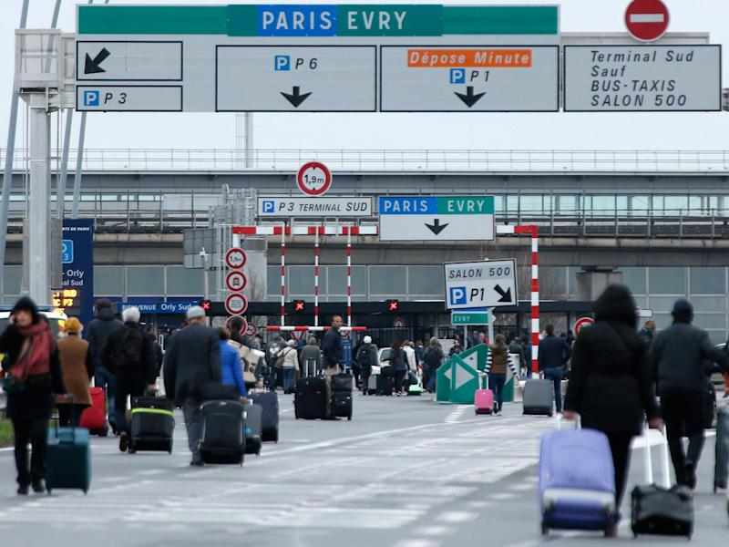 Passengers evacuated from Paris Orly airport on 18 March (AP)