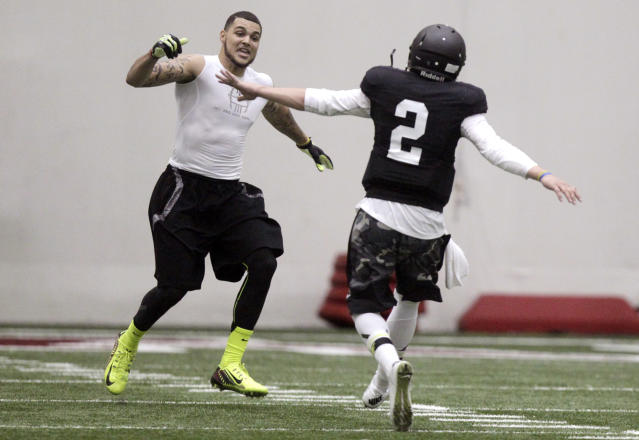 Texas A&M quarterback Johnny Manziel (2) and wide receiver Mike Evans celebrate after a pass reception during a drill at pro day for NFL football representatives in College Station, Texas, Thursday, March 27, 2014. (AP Photo/Patric Schneider)