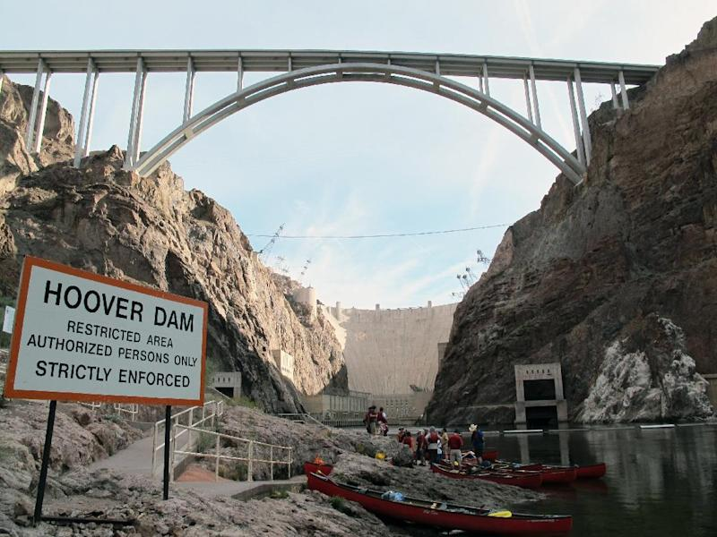 This April 13, 2013 photo shows the put-in area at the base of the Hoover Dam, outside of Boulder City, Nev.,for trips on the Colorado River by kayak, canoe and raft. The dam's power plant is located in a restricted security zone, but so anyone looking to paddle there must be escorted by government-authorized livery services or outfitters. Some of the guide companies will pick you up at your hotel on the Las Vegas Strip some 30 miles away first thing in the morning and have you in the water before lunch. (AP Photo/Karen Schwartz)
