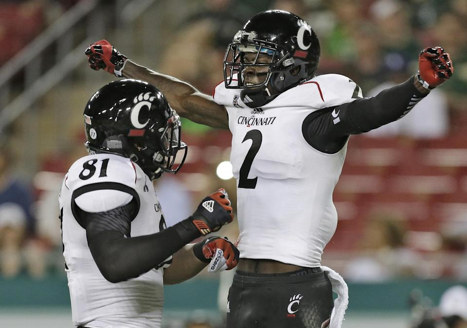 Cincinnati wide receiver Mekale McKay (2) celebrates with teammate tight end DJ Dowdy (81) after scoring ad touchdown during the second quarter of an NCAA college football game against South Florida Bulls on Saturday, Oct. 5, 2013, in Tampa, Fla. (AP Photo/Chris O'Meara)