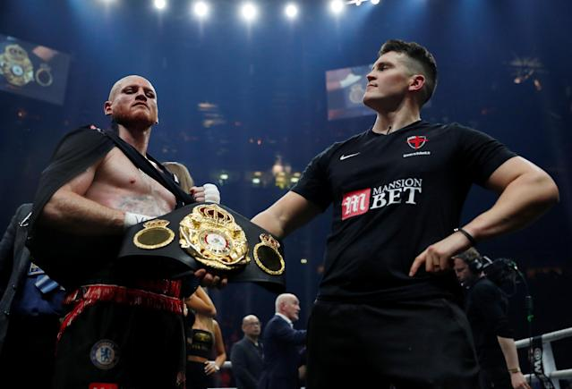 Boxing - World Boxing Super Series Semi Final - George Groves vs Chris Eubank Jr - WBA & IBO World Super-Middleweight Titles - Manchester Arena, Manchester, Britain - February 17, 2018 George Groves and Shane McGuigan celebrate with the belt after the fight Action Images via Reuters/Andrew Couldridge