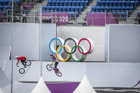 <p>TOKYO, JAPAN - JULY 31: Athletes practice before the Men's BMX Freestyle seeding event at Ariake Urban Sports Park on July 31, 2021 in Tokyo, Japan. Despite a surge in Covid-19 cases in Tokyo, Japanese Prime Minister Yoshihide Suga stated on Friday that adequate measures are in place to prevent coronavirus infections spreading from Olympic athletes and staff to the wider population. Mr Suga also announced that Tokyo's neighbouring prefectures of Chiba, Kanagawa, Saitama will be added to the state of emergency that currently covers the capital and which runs through to August 31st. (Photo by Yuichi Yamazaki/Getty Images)</p>