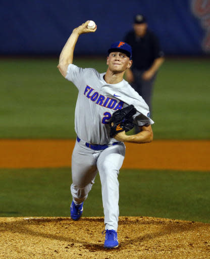Florida pitcher Jack Leftwich throws during the first inning of a Southeastern Conference tournament NCAA college baseball game against LSU, Friday, May 25, 2018, in Hoover, Ala. (AP Photo/Butch Dill)