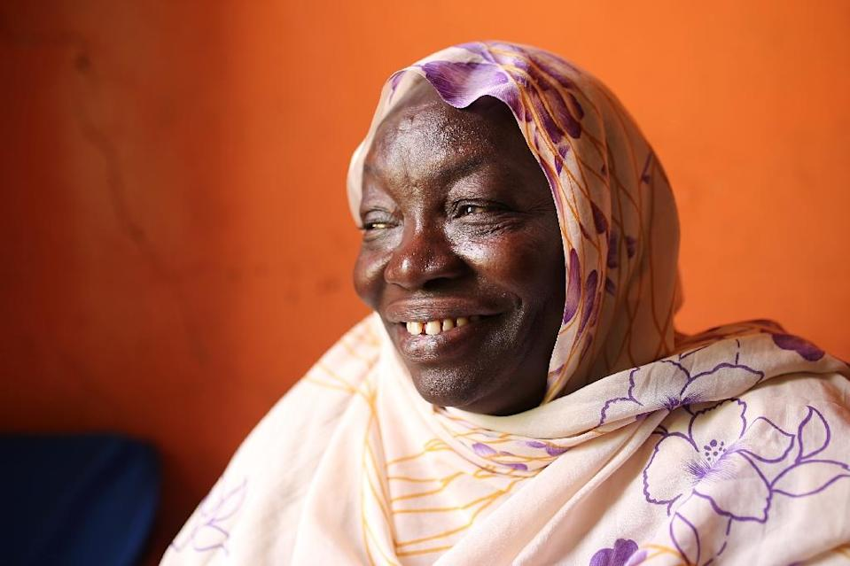 Through 20 years' selling tea by searing-hot Khartoum roadsides, Awadeya Mahmoud dreamed of improving conditions for her co-workers, mostly from conflict-hit areas like herself, but never imagined it would lead to the White House. (AFP Photo/Tom Little )