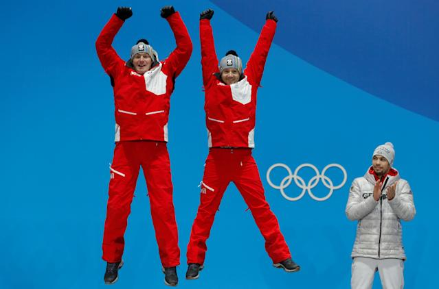 Medals Ceremony - Luge - Pyeongchang 2018 Winter Olympics - Men's Doubles - Medals Plaza - Pyeongchang, South Korea - February 16, 2018 - Silver medalists Peter Penz and Georg Fischler of Austria on the podium. REUTERS/Eric Gaillard TPX IMAGES OF THE DAY