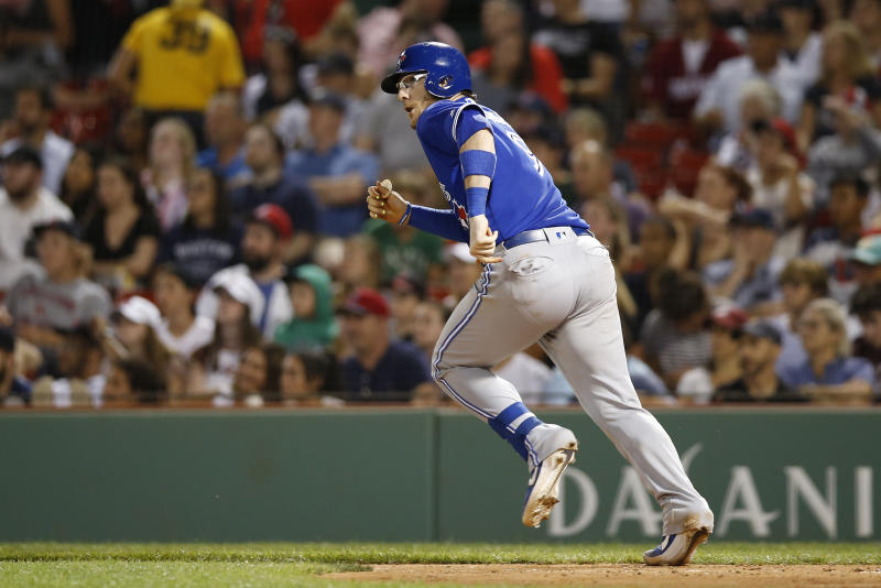 Jul 15, 2019; Boston, MA, USA; Toronto Blue Jays catcher Danny Jansen (9) hits an RBI single against the Boston Red Sox during the eighth inning at Fenway Park. Mandatory Credit: Greg M. Cooper-USA TODAY Sports