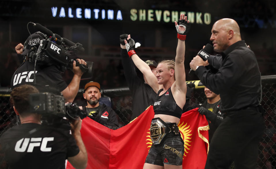 Valentina Shevchenko celebrates after defeating Jessica Eye during their women's flyweight title mixed martial arts bout at UFC 238, Saturday, June 8, 2019, in Chicago. (AP Photo/Kamil Krzaczynski)