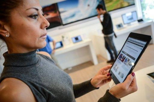Customers look at the new iPad mini at an Apple store in Rome. Apple's new iPad mini debuted on Friday with less fanfare than previous incarnations amid talk it might have come too late to the 7-inch tablet computer market