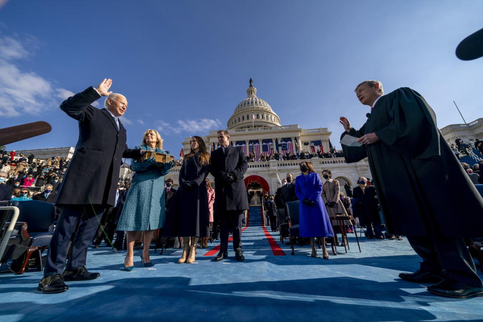 US President-elect Joe Biden is sworn in as the 46th president of the United States by Chief Justice John Roberts as Jill Biden holds the Bible during the inauguration. Source: AAP