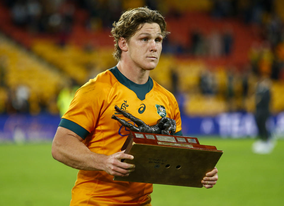 Australia's captain Michael Hooper holds the trophy aloft after defeating France in the third rugby international at Suncorp Stadium in Brisbane, Australia, Saturday, July 17, 2021. (AP Photo/Tertius Pickard)