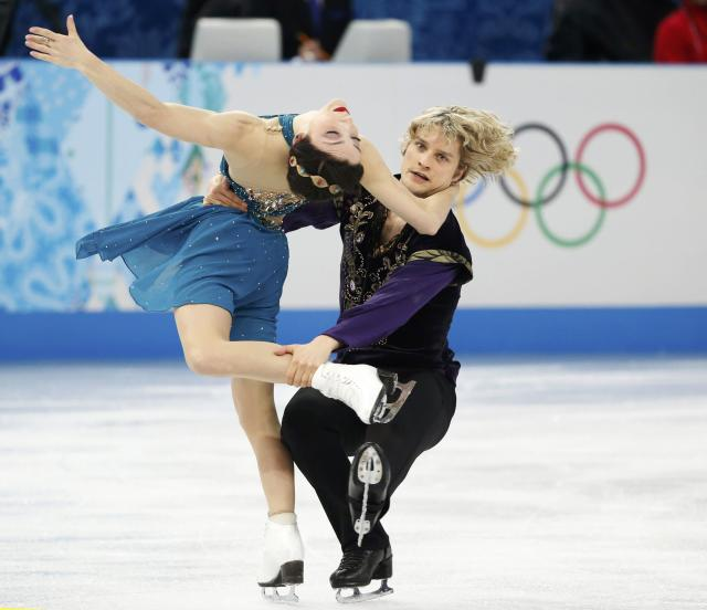 Meryl Davis and Charlie White of the United States figure skating team compete during the Team Ice Dance Free Dance at the Sochi 2014 Winter Olympics, February 9, 2014. REUTERS/Lucy Nicholson (RUSSIA - Tags: SPORT FIGURE SKATING SPORT OLYMPICS)
