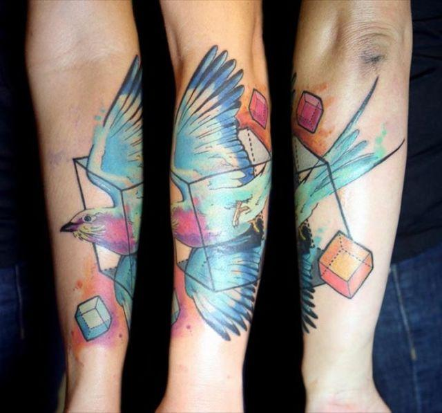 """<p>This striking bird tattooed on Savannah Peterson<span></span> by artist <a rel=""""nofollow"""" href=""""https://www.instagram.com/graphicward/?hl=en"""">Deanna Wardin</a>features a dynamic blend of turquoise, magenta, tangerine and other colors that pop.</p>"""