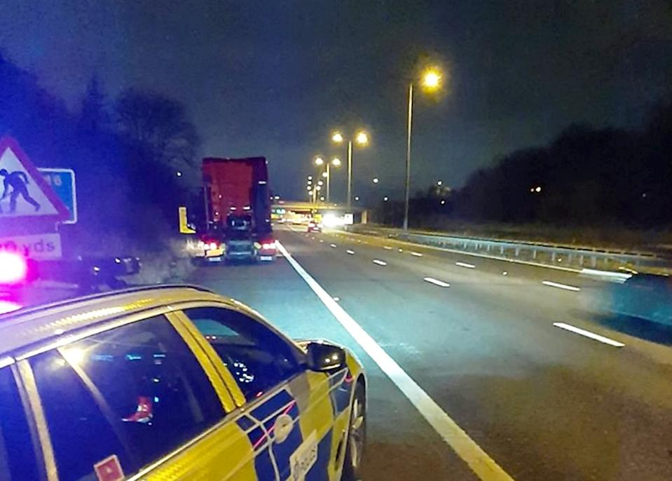 Police closed down part of the M6 motorway after the drunken Polish lorry driver fell out of his cab (Picture: SWNS)