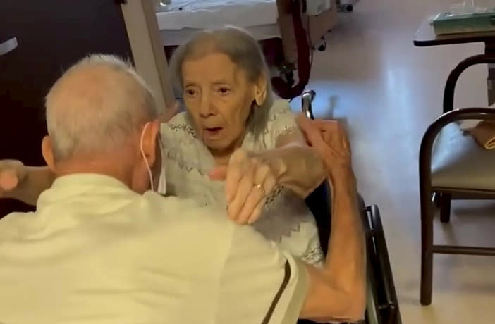 This is the adorable moment an elderly couple married for 73 years were reunited in a care home after spending nearly a whole year apart. (SWNS)
