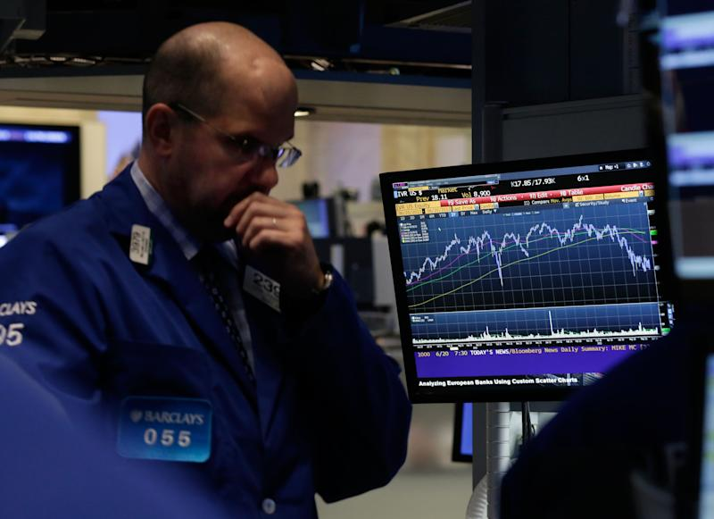 Specialist John Urbanowicz works on the floor of the New York Stock Exchange, Thursday, June 20, 2013. Financial markets are sliding after the Federal Reserve said it could end its huge bond-buying program by the middle of next year. (AP Photo/Richard Drew)