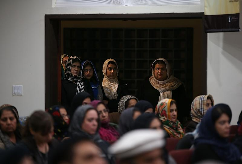Women look on during a prayer vigil at Baitul Hameed Mosque on December 3, 2015 in Chino, California