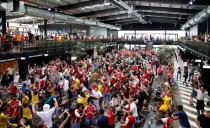 Arsenal fans watch the FA Cup Final between Arsenal and Chelsea
