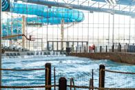 """<p>The bigger-is-better set can beeline for the five-year-old Kalahari Resorts Poconos (a spin-off of an expanding Wisconsin Dells-based brand), so named for the Kalahari Desert. Touting a scale of epic proportions, the resort has nearly 1,000 rooms (including a unit that can house 22 guests) and a cavernous indoor water park; at 220,000 square feet and set under a massive, climate-controlled dome, it's America's largest (at least until a new Kalahari Resorts Texas location opens in mid-November, which will outsize it). Dive into the aquatic adventure-land—kept at 84 degrees year-round—with features like a wave pool, lazy river, surf simulator, 32 wild waterslides, or, new for 2020, an underwater virtual reality experience (courtesy of waterproof VR headsets and masks). Plus, find age-appropriate retreats, from a toddlers' splash zone to an adults-only swim-up bar. Note that water park occupancy is limited to 50 percent capacity, and social distancing throughout the park is enforced; chairs and loungers are spread out and sanitized frequently.</p> <p>Beyond the water park, a massive arcade has games, escape rooms, virtual reality experiences, bowling, and laser tag, while seasonal outdoor pursuits include a water park extension and a ropes course, mini golf, and zip-lining. A spa offering hydrotherapy and halotherapy (with a junior spa space for kids ages three to nine) and 17 on-site bars and restaurants make the case for an overnight stay. Granted, indoor entertainment isn't everybody's speed during the COVID-era, so if you're not quite ready for this type of experience, consider bookmarking the resort for a visit in late 2021—or beyond.</p> <p><strong>Book now:</strong> Rates from $179/room, plus a $40/nightly resort fee; <a href=""""https://www.kalahariresorts.com/pennsylvania/"""" rel=""""nofollow noopener"""" target=""""_blank"""" data-ylk=""""slk:kalahariresorts.com/pennsylvania"""" class=""""link rapid-noclick-resp"""">kalahariresorts.com/pennsylvania</a>. <em>Note the resort's kids' clu"""