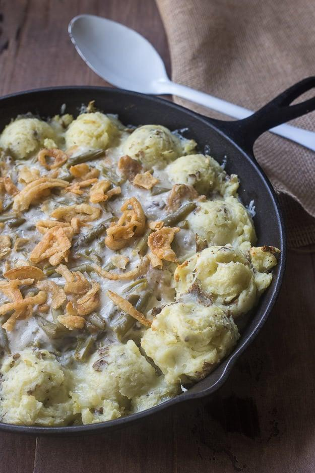 """<p>Combine your favorite side dishes into the ultimate holiday side.</p> <p><b>Get the recipe:</b> <a href=""""https://www.azestybite.com/mashed-potato-green-bean-casserole/"""" class=""""link rapid-noclick-resp"""" rel=""""nofollow noopener"""" target=""""_blank"""" data-ylk=""""slk:mashed potato green bean casserole"""">mashed potato green bean casserole</a></p>"""