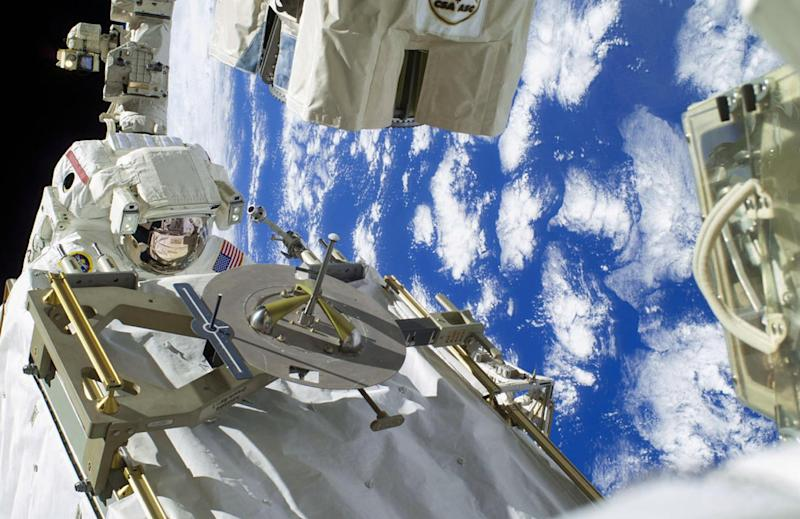 This December 22, 2013 NASA image shows an astronaut participating in a spacewalk designed to troubleshoot a faulty coolant pump on the International Space Station