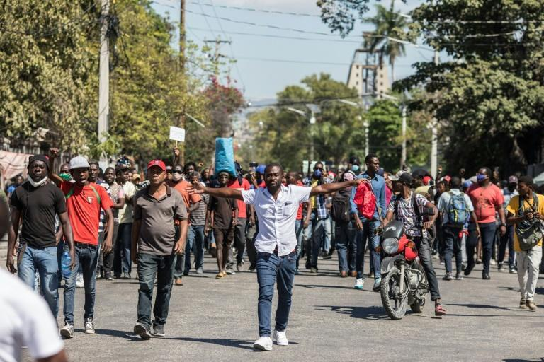 Demonstrators march in Port-au-Prince on February 10, 2021, to protest against the government of President Jovenel Moise