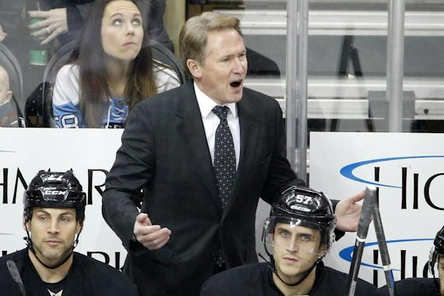 Pittsburgh Penguins coach Mike Johnston disagrees with an official during the first period of an NHL hockey game against the Ottawa Senators in Pittsburgh Saturday, Dec. 6, 2014. The Penguins won 3-2. (AP Photo/Gene J. Puskar)