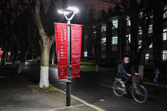"""A banner at Fudan University in Shanghai calls for institutions to adhere to the political philosophy of Chinese President Xi Jinping. <span class=""""copyright"""">(Hector Retamal / AFP/Getty Images)</span>"""