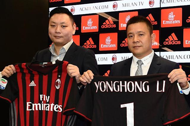 Chinese businessman Yonghong Li (right) was named as AC Milan's new president after his $786 million takeover of the Serie A side (AFP Photo/MIGUEL MEDINA)