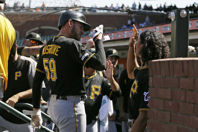 Pittsburgh Pirates' Joe Musgrove is greeted in the dugout after scoring the team's third run in the fifth inning of a baseball game against the San Francisco Giants, Thursday, Sept. 12, 2019, in San Francisco. (AP Photo/Eric Risberg)