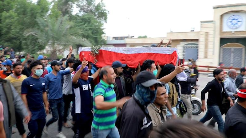 The coffin of a protester reportedly killed by Iraqi police is taken through the city of Nasiriyah