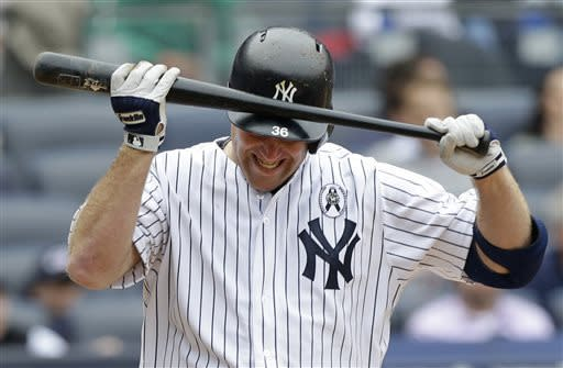 New York Yankees Kevin Youkilis reacts after striking out and stranding two runners in the seventh inning of an Opening Day baseball game against the Boston Red Sox at Yankee Stadium in New York, Monday, April 1, 2013. (AP Photo/Kathy Willens)