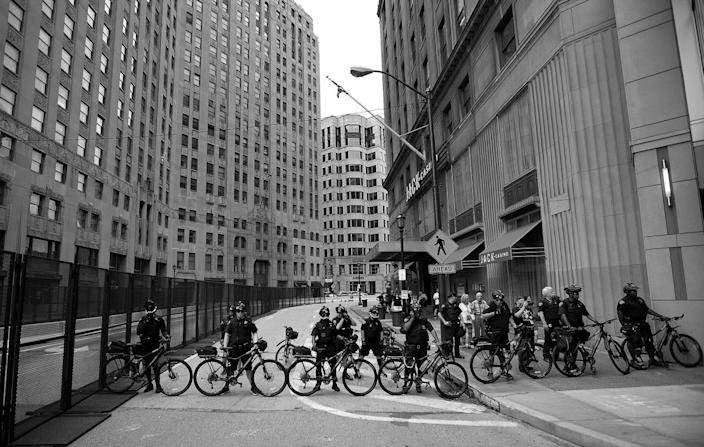 <p>Bicycle officers seal off an area from anti-Trump demonstrators in Cleveland. (Photo: Khue Bui for Yahoo News)</p>