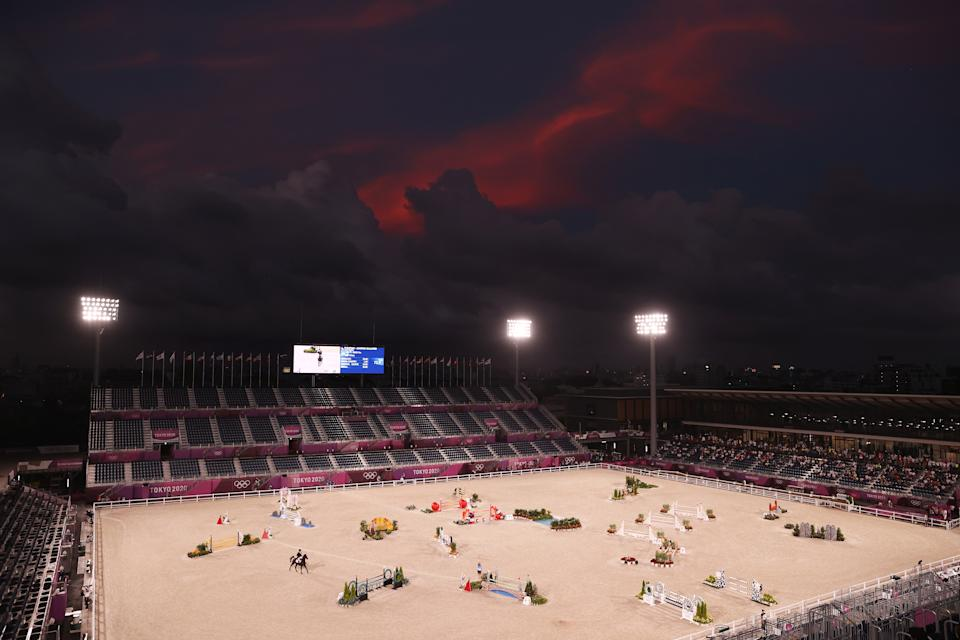 <p>TOKYO, JAPAN - AUGUST 02: Tim Price of Team New Zealand riding Vitali competes during the Eventing Jumping Team Final and Individual Qualifier on day ten of the Tokyo 2020 Olympic Gamesat Equestrian Park on August 02, 2021 in Tokyo, Japan. (Photo by Julian Finney/Getty Images)</p>