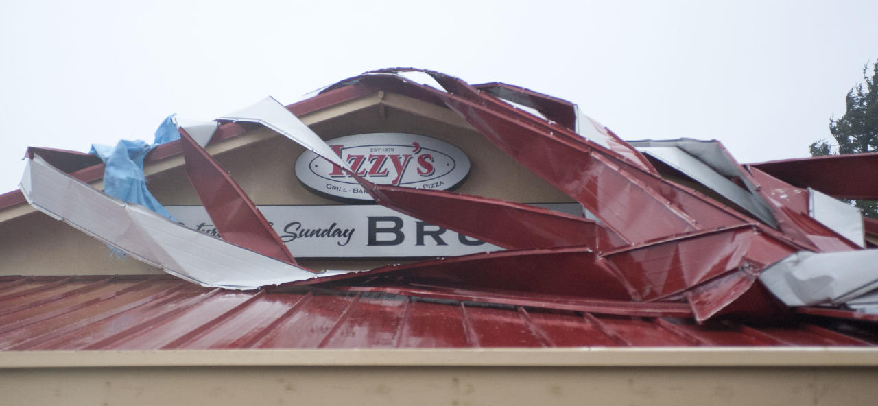Sections of Izzy's restaurant roof have been torn off overnight in high winds that have hit the Oregon coast in Newport, Ore., Monday, Nov. 19, 2012. (AP Photo/The Oregonian, Brent Wojahn)