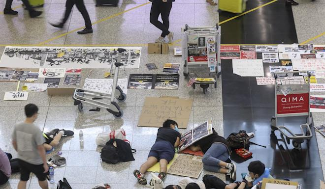 Some protesters remained in the terminal on Wednesday morning. Photo: K.Y. Cheng