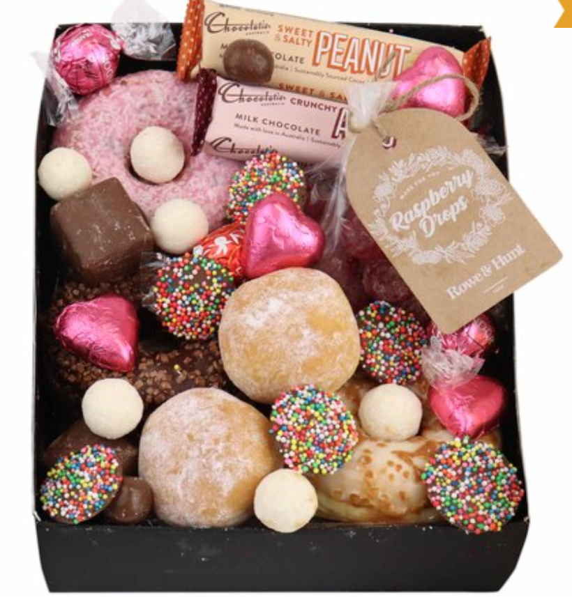 Five doughnuts on a bed of chocolates
